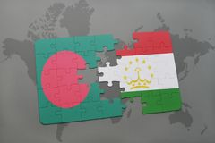 Puzzle with the national flag of bangladesh and tajikistan on a world map background. Royalty Free Stock Photography
