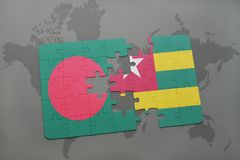 Puzzle with the national flag of bangladesh and togo on a world map Stock Image