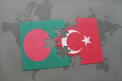 Puzzle with the national flag of bangladesh and turkey on a world map background. Royalty Free Stock Images