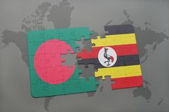 Puzzle with the national flag of bangladesh and uganda on a world map Stock Images