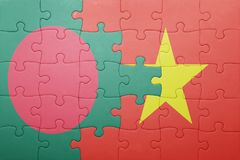 Puzzle with the national flag of bangladesh and vietnam Stock Photos