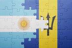 Puzzle with the national flag of barbados and argentina Stock Photography