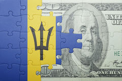 Puzzle with the national flag of barbados and dollar banknote Stock Images
