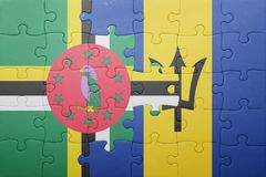 Puzzle with the national flag of barbados and dominica. Concept stock photos