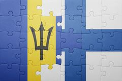 Puzzle with the national flag of barbados and finland Royalty Free Stock Photography