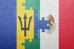 Puzzle with the national flag of barbados and mexico. Concept stock photos