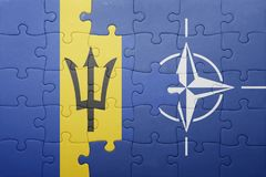 Puzzle with the national flag of barbados and nato. Concept stock photography