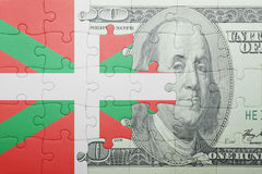 Puzzle with the national flag of basque country and dollar banknote Royalty Free Stock Images