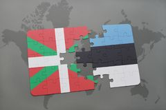 Puzzle with the national flag of basque country and estonia on a world map background. 3D illustration Stock Images