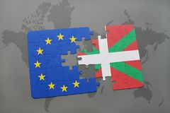 Puzzle with the national flag of basque country and european union on a world map Royalty Free Stock Photo