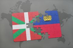 Puzzle with the national flag of basque country and liechtenstein on a world map background. 3D illustration Stock Photography