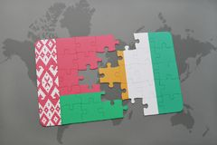 Puzzle with the national flag of belarus and cote divoire on a world map. Background. 3D illustration Royalty Free Stock Photos