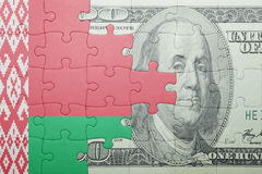 Puzzle with the national flag of belarus and dollar banknote Stock Photos