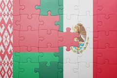 Puzzle with the national flag of belarus and mexico. Concept stock photography
