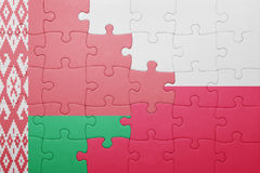 Puzzle with the national flag of belarus and poland. Concept Stock Photo