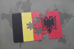 puzzle with the national flag of belgium and albania on a world map background. Royalty Free Stock Images