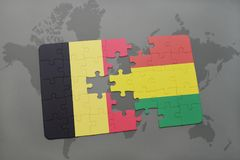 puzzle with the national flag of belgium and bolivia on a world map background. Royalty Free Stock Images