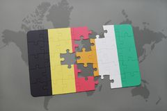 Puzzle with the national flag of belgium and cote divoire on a world map background. 3D illustration Stock Photo