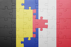 Puzzle with the national flag of belgium and france. Concept Stock Image