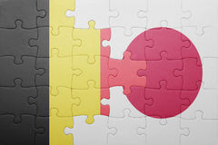 Puzzle with the national flag of belgium and japan. Concept Stock Images