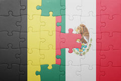 Puzzle with the national flag of belgium and mexico. Concept royalty free stock image