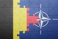 Puzzle with the national flag of belgium and nato. Concept stock images