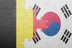 Puzzle with the national flag of belgium and south korea. Concept royalty free stock photo