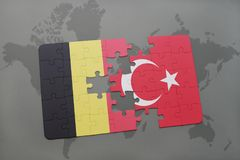 Puzzle with the national flag of belgium and turkey on a world map background. 3D illustration stock image