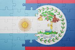 Puzzle with the national flag of belize and argentina Stock Photos