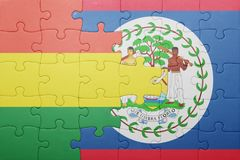 Puzzle with the national flag of belize and bolivia Royalty Free Stock Photos