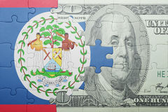 Puzzle with the national flag of belize and dollar banknote Stock Photo