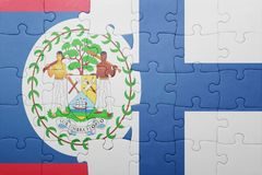 Puzzle with the national flag of belize and finland Stock Images