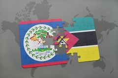 Puzzle with the national flag of belize and mozambique on a world map. Background. 3D illustration Royalty Free Stock Photos