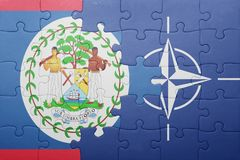 Puzzle with the national flag of belize and nato Royalty Free Stock Photography
