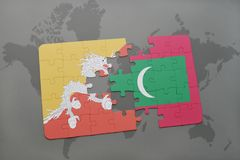Puzzle with the national flag of bhutan and maldives on a world map background. 3D illustration Stock Photos