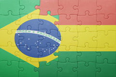 Puzzle with the national flag of bolivia and brazil. Concept Royalty Free Stock Photography