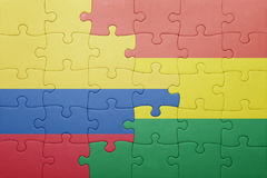Puzzle with the national flag of bolivia and colombia. Concept Royalty Free Stock Images