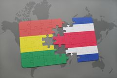 puzzle with the national flag of bolivia and costa rica on a world map background. Stock Photos