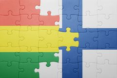 Puzzle with the national flag of bolivia and finland Royalty Free Stock Photo