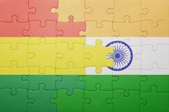Puzzle with the national flag of bolivia and india Stock Images