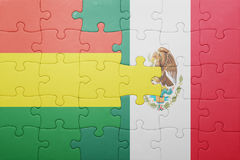 Puzzle with the national flag of bolivia and mexico. Concept stock image