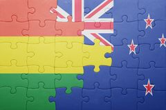 Puzzle with the national flag of bolivia and new zealand Stock Image