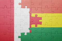 Puzzle with the national flag of bolivia and peru. Concept Royalty Free Stock Images