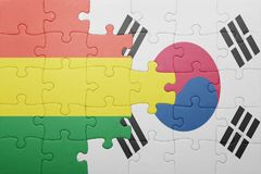 Puzzle with the national flag of bolivia and south korea. Concept stock photos