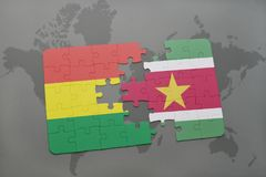 Puzzle with the national flag of bolivia and suriname on a world map background. 3D illustration Royalty Free Stock Photos