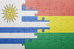 Puzzle with the national flag of bolivia and uruguay. Concept Stock Photography