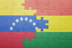 Puzzle with the national flag of bolivia and venezuela. Concept Royalty Free Stock Image