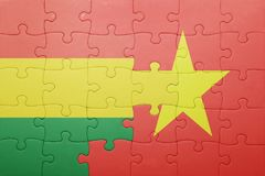 puzzle with the national flag of bolivia and vietnam Stock Image