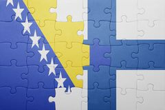 Puzzle with the national flag of bosnia and herzegovina and finland Stock Image