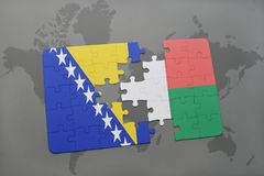 Puzzle with the national flag of bosnia and herzegovina and madagascar on a world map. Background. 3D illustration Stock Photography